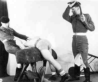 squaddie in shorts belted on gym horse: photo by Studio Royale, London