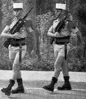 légionnaires on guard duty in boots and shorts uniform